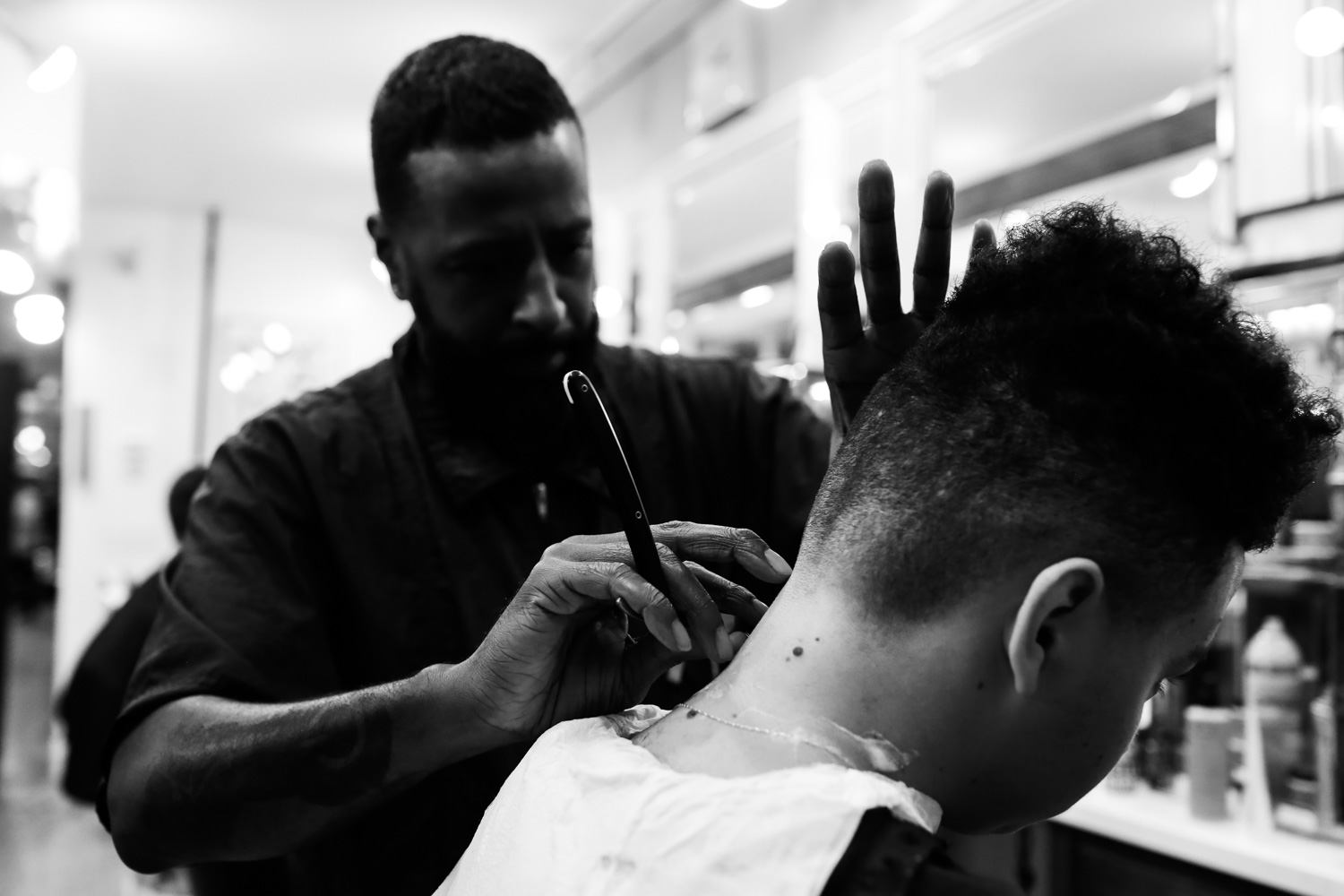 Lined Up Evolution Of The Black Barber Shop Bevel