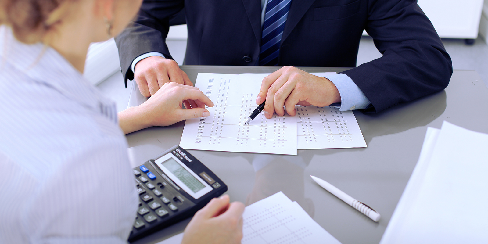 HR Professionals Working On Payroll Compliance