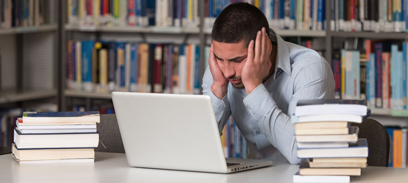 A student suffers from stress and anxiety over his large amount of coursework.