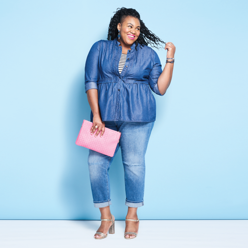 A woman wearing a plus size outfit including head-to-toe denim and holding a pink purse