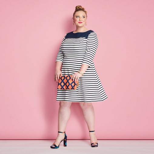 A woman wearing a plus size striped dress with patterned heels for spring fashion trends