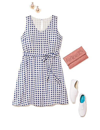 A plus size gingham dress with white sneakers