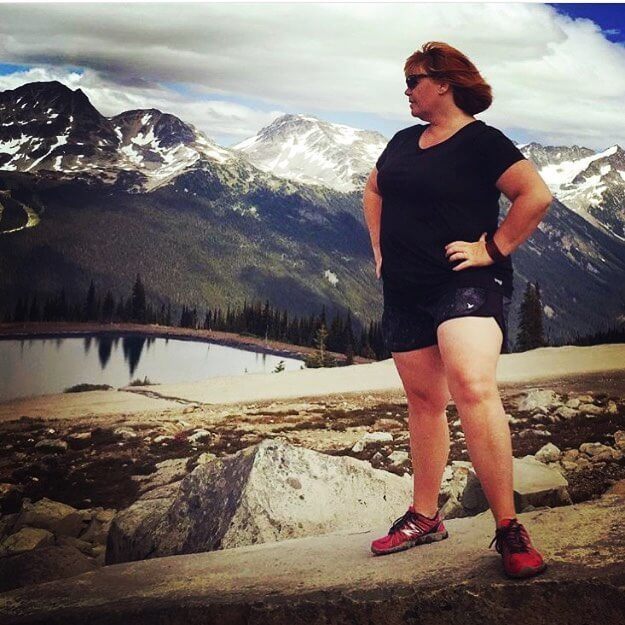 plus size influencer and trainer Louise Green hiking on a mountain