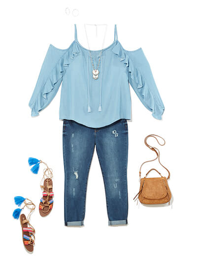 One of many boho outfits available at Dia&Co, this plus size outfit features plus size denim, a cold-shoulder blue top, and tasseled sandals.