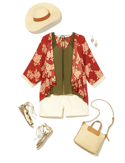 One of many boho outfits available at Dia&Co, this plus size outfit includes a red floral kimono, white denim shorts, and a green top.