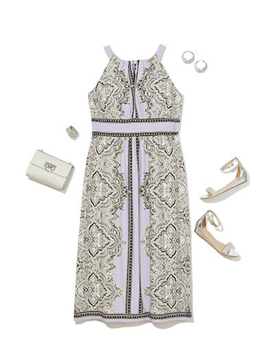 One of many boho outfits available at Dia&Co, this plus size outfit features a paisley-printed maxi dress and white accessories.