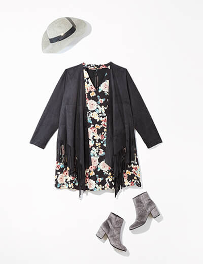One of many boho outfits available at Dia&Co, this plus size outfit features a floral dress, black jacket, and grey booties.