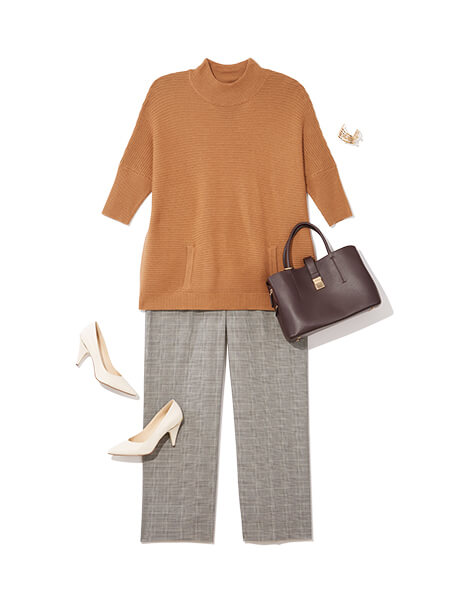 One of many classic outfits available at Dia&Co, this plus size outfit includes a tan sweater, plaid pants, and ivory pumps.