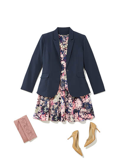 One of many classic outfits available at Dia&Co, this plus size outfit features a dark blazer, floral dress, heels, and pink clutch.