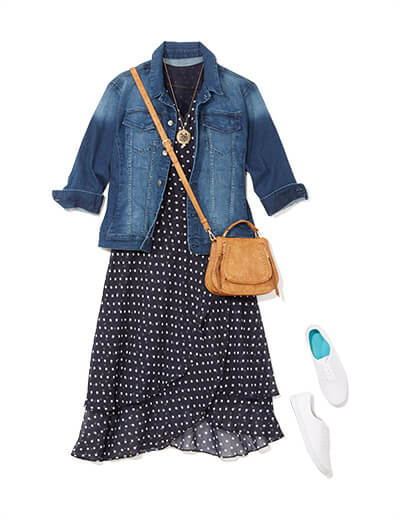 One of many casual outfits available at Dia&Co, this plus size outfit includes a plus size polka dotted dress, crossbody bag, white sneakers, and a denim jacket.