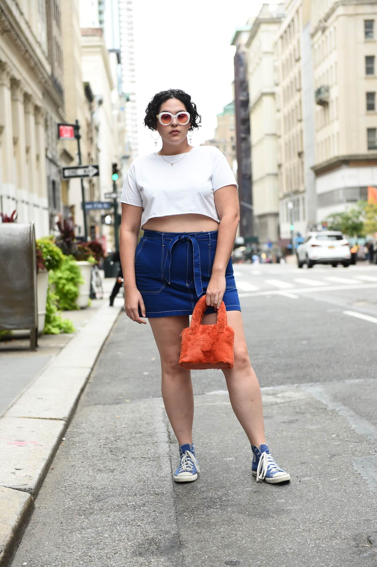 1fe416e2fbd plus size street style look featuring a white crop top and denim skirt