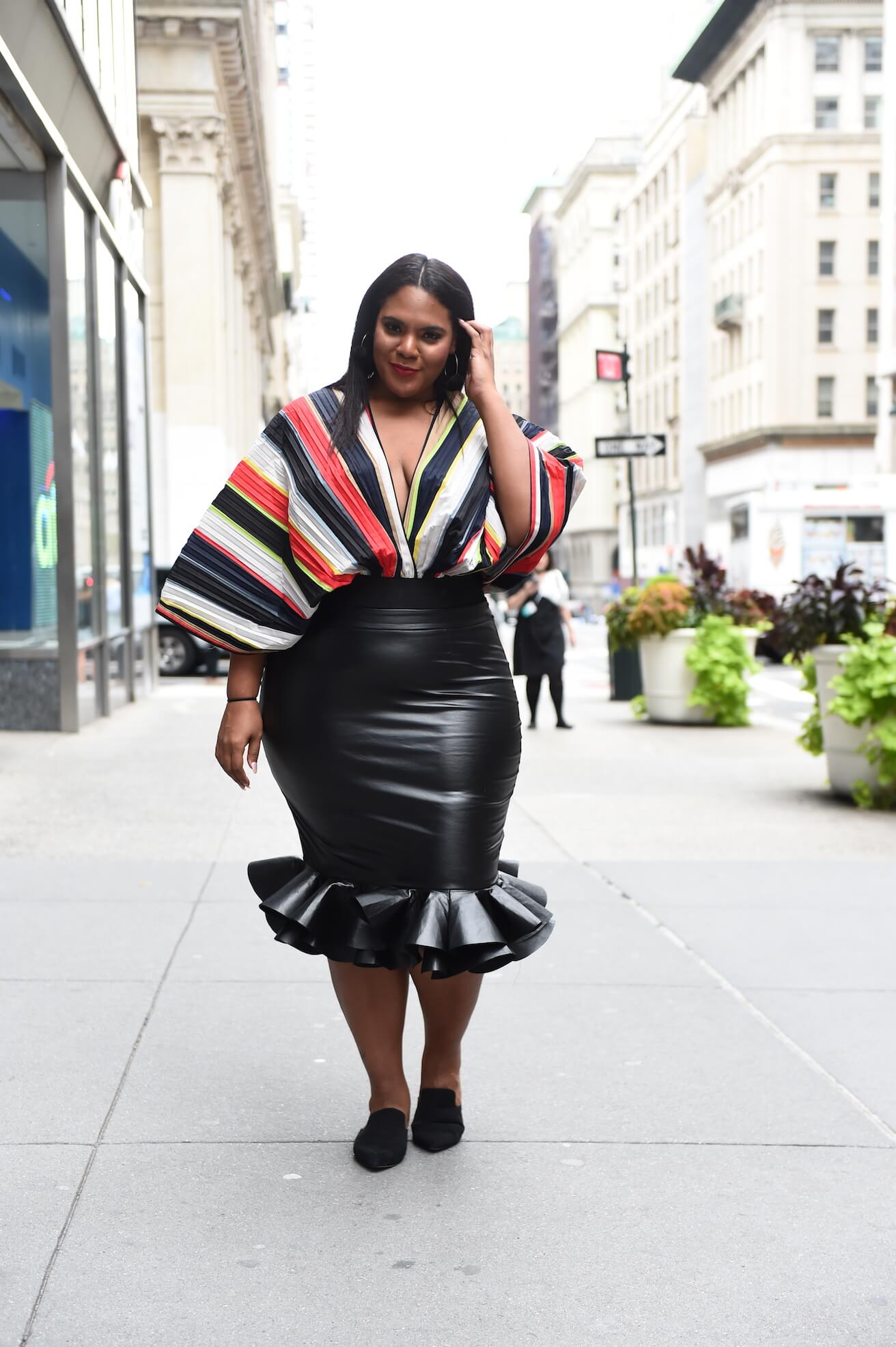 0228b045226 plus size street style featuring a black skirt and bold top