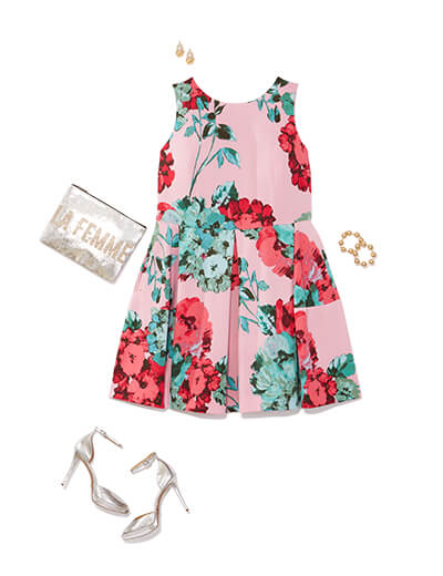 This glam outfit features a pink floral dress and silver accessories.