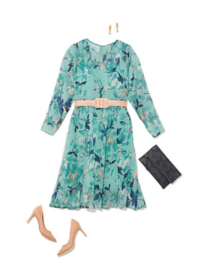 Featuring traditional style, this outfit features a long-sleeved dress with a high neckline with neutral accessories.