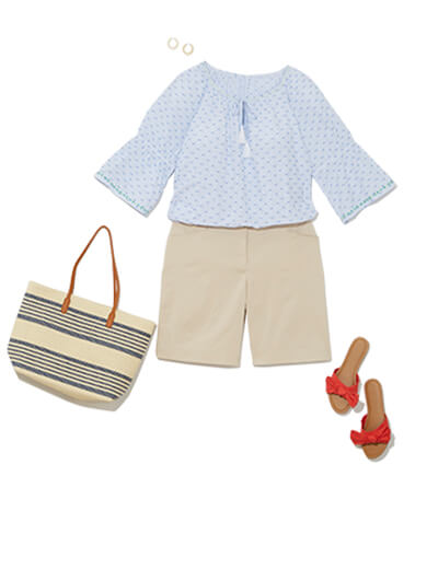 This traditional style outfit features a khaki Bermuda short, flowy peasant top and red slides.
