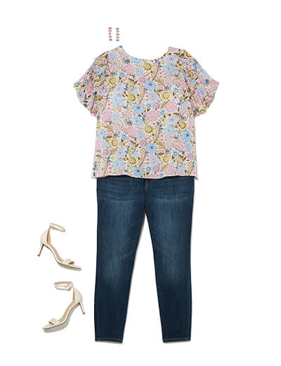Featuring traditional style, this outfit features a crew neck blouse, dark wash denim and neutral heels.