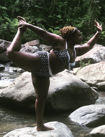 Deanna shows off a challenging yoga pose, while balanced on a rock