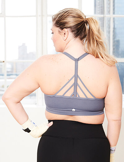 plus size strappy sports bra on model