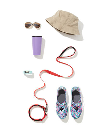 Hiking gear including a dog leash, hat, hiking boots, watch, and sunglasses