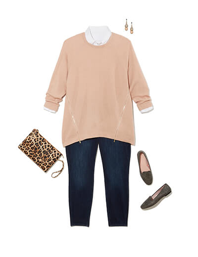 Winter outfit featuring pink sweater layered over white button-down.