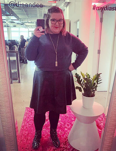 plus-size clothing gray sweater pendant necklace leather skirt tights