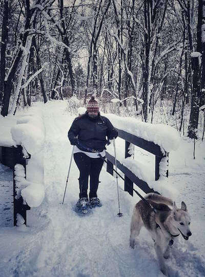 Andrea DiMaio on a hike in the snow with her dog, Rammu