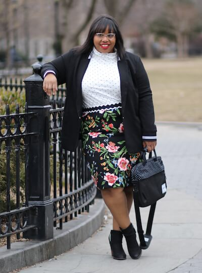Jami in a stylish plus-size workwear ensemble.
