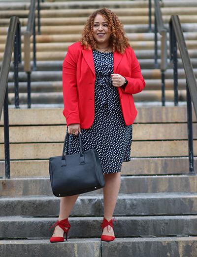 Sandra in a stylish plus-size workwear ensemble.
