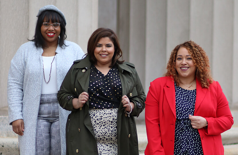 Darlene, Jami, and Sandra in stylish plus-size workwear ensembles.