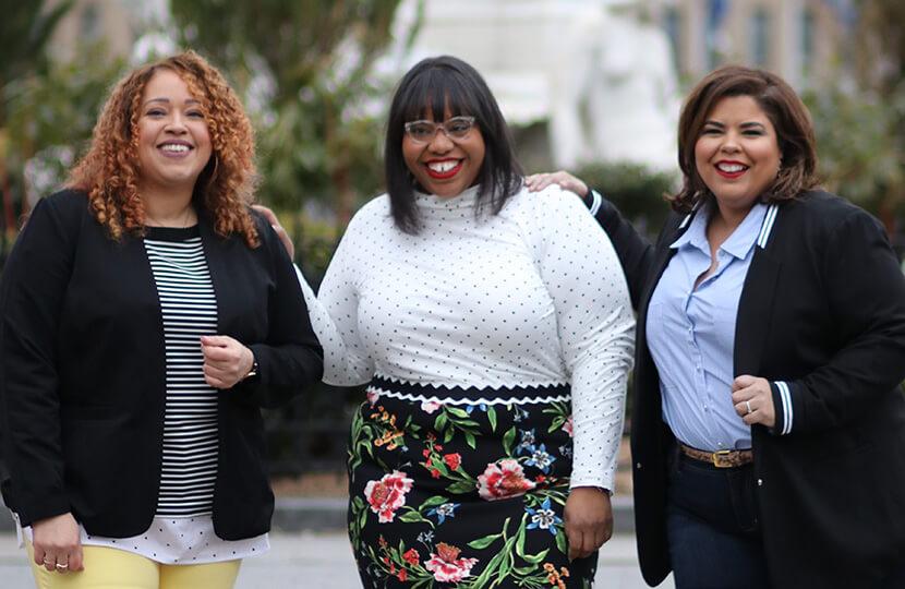 Sandra, Jami, and Darlene in stylish plus-size workwear.