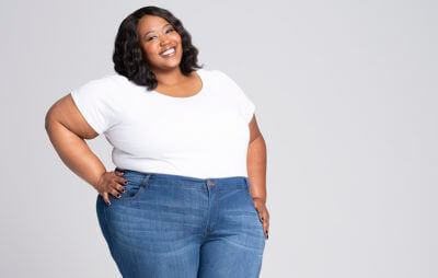 defining your body woman in plus size skinny jeans and white t-shirt