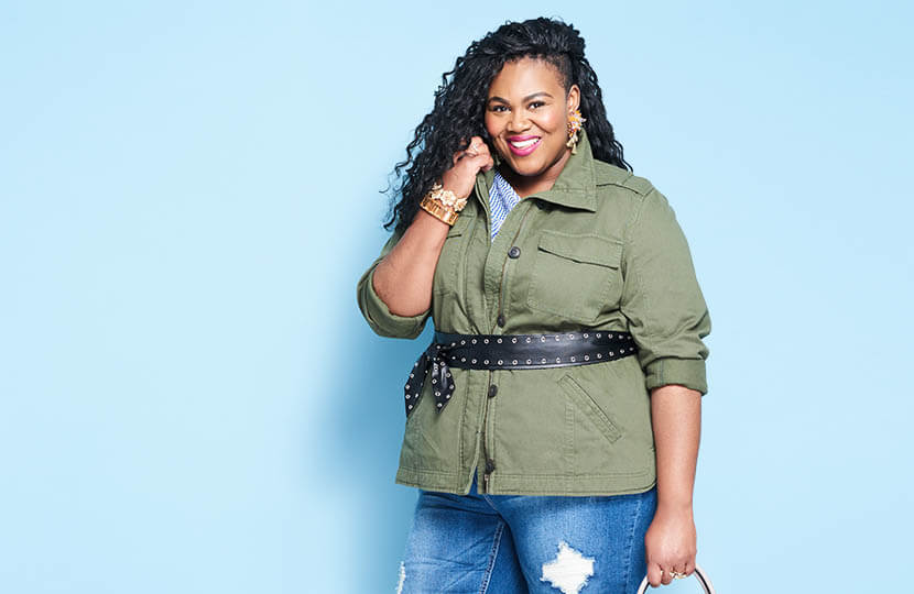 Plus size model wearing light layers for spring.