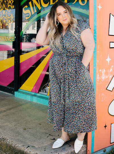 plus size model in colorful printed jumpsuit