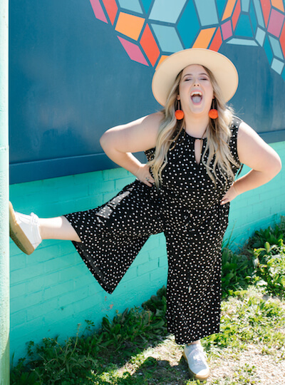 model wearing a plus size polka dot jumpsuit