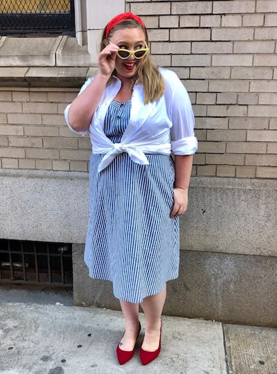 Ashby in a retro outfit featuring a white button-down.