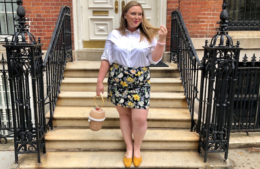 Ashby in a preppy outfit featuring a white button-down.