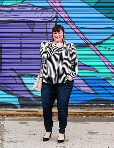 plus-size outfit photos striped shirt black jeans graffiti wall