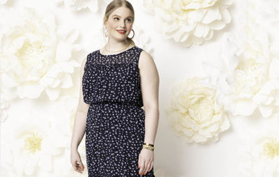 Plus size model in dotted maxi dress.