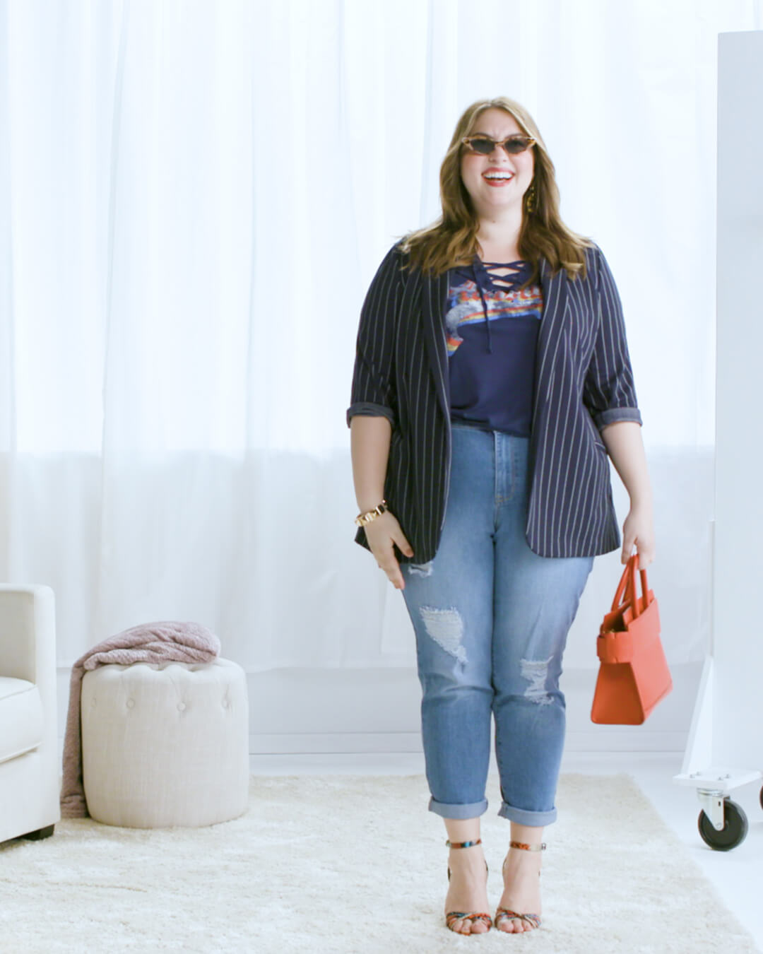 plus-size blazer over graphic tee distressed denim sunglasses bright bag