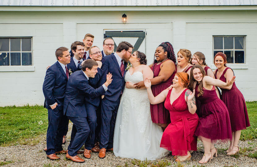 plus size bride and groom with bridal party