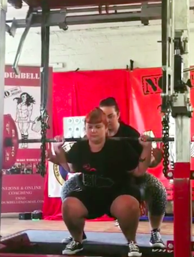 plus size women weight lifting with trainer