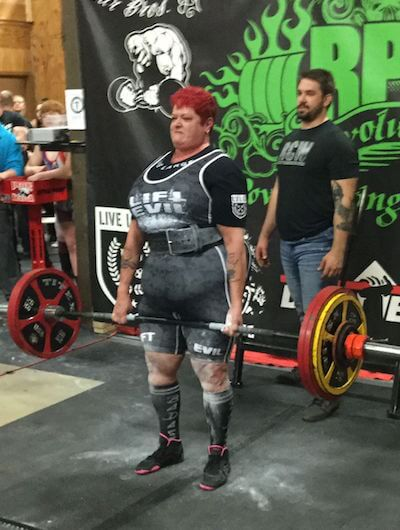 plus size woman competing in weight lifting competition