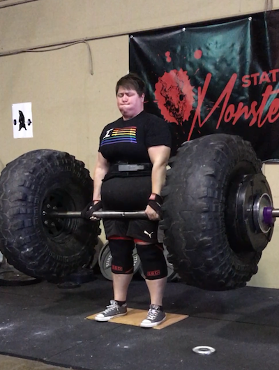 plus size woman lifting large weight