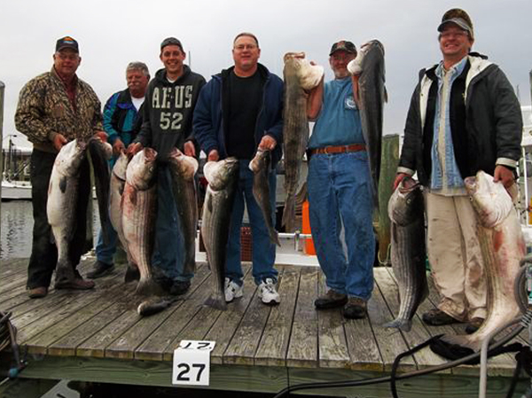 company fishing trip group photo