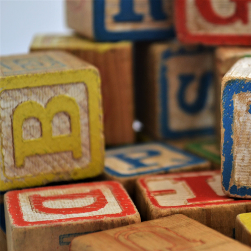 wooden toy blocks stacked on one another