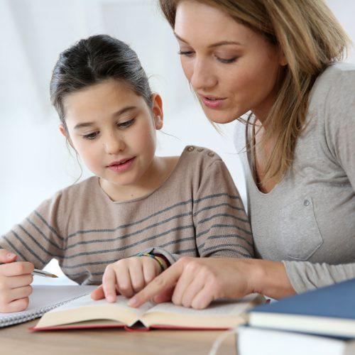 25842138 - mom helping kid with homework