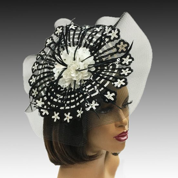 FA2321 CAROUSEL FASCINATOR ( Striking Black and White Sequin Pinwheel  Fascinator on an Illusion Base )