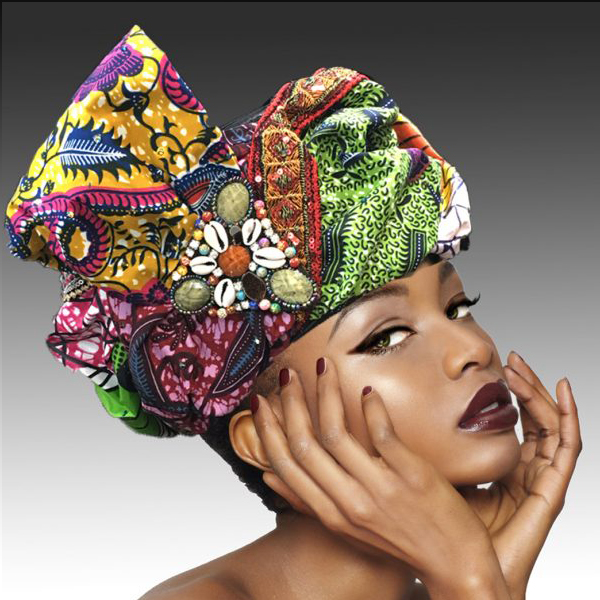 2220 Micmac-MU ( Turban Style Pillbox In A Melange Of Richly Hued Tribal Fabrics And Hand Beaded Motif )