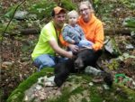 Ashley Ridenour of Newburg, W.va. with her first ever black bear, a moment shared with her husband and 2-year old