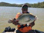 Brad Cayton of Buckhannon, W.Va. with a monster crappie he caught and released in April 2019 fishing at Burnsville Lake.  The big fish weighed 3 pounds-8 ounces